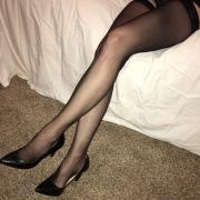 Le lunghe gambe in autoreggenti
