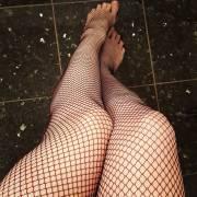 Le gambe di Nancy con le calze a rete